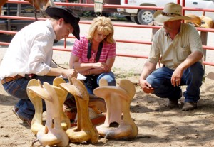 Scott Thomas, a saddlemaker from Campbell, Texas, writes up a saddle order for Linda and Greg Schuetz of Paxico.
