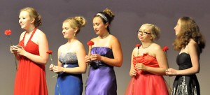 Five senior girls receive a bouquet of flowers as they say goodbye at their last EDC recital.