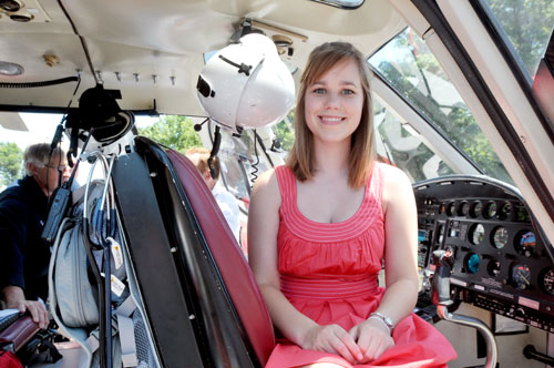 Holly Bodenheimer poses inside the LifeStar helicopter as it sits on a new parking pad.