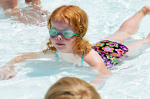 "Lauren Thomas, 4, explores the water with her goggles and exclaims, ""I think I see something under there!"""