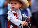 Stone Newell, 2, rides a pony through the children's parade during the Old Settlers' Reunion in Oskaloosa.