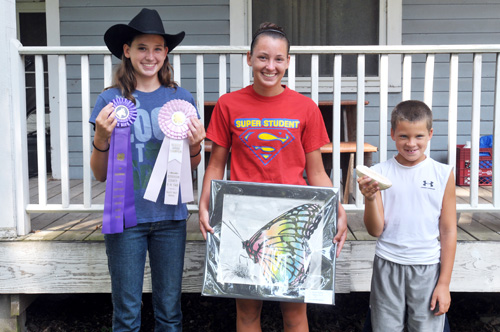 Justine, Jessie, and John Frakes show off their projects that will be presented at the 4-H fair in Valley Falls.
