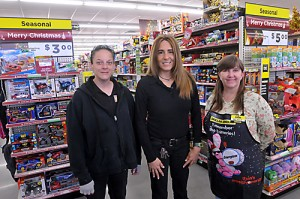 A new Dollar General opened its doors last week at Valley Falls. The manager is Kerri Oliva, center, shown here with her assistant Angie Barnhardt, left, and cashier Michele Wickwar.