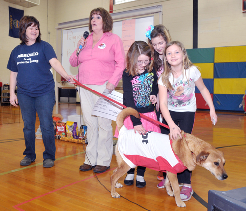 "Jefferson County Humane Society representatives Sherry Ross and Sandy Harvey accepted a donation from the children at Jefferson West Elementary. Given credit for the ""Pennies for Pets"" idea are three third-graders, Josie Dove, Taylor Zwygart and Kierstyn Sutton, shown here petting Bristol."