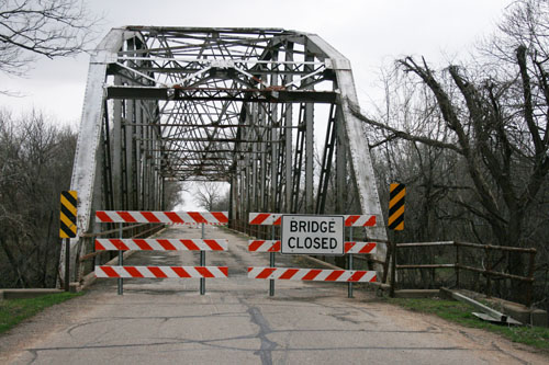 The old U.S. 24 Highway bridge over the Delaware River in Perry was shut down over the weekend permanently due to major damage to the bridge's underlying support system.