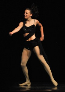 """Emily Nottingham, Valley Falls, portrays expression and emotion during her lyrical solo, """"Skyscraper."""" Photo by Clarke Davis"""