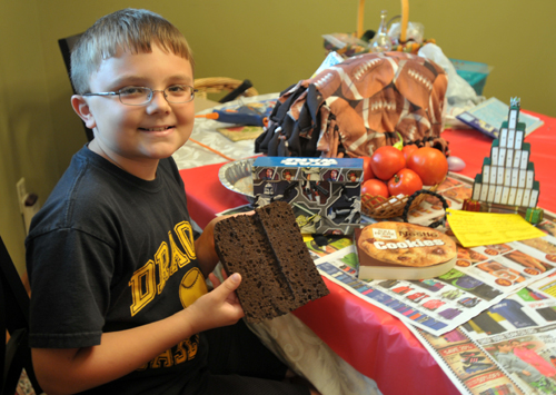 Photo by Holly Davis Gage Burdiek, 10, Valley Falls, is pictured at his dining room table where he does most of his arts and crafts that will be entered in the Jefferson County 4-H fair. Hoping for that purple ribbon, kids like Gage have been preparing projects for the fair all year long.