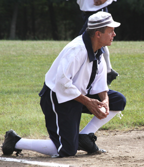 Hodgeman third baseman looks for who to throw the ball to after picking up a ground hit in the vintage baseball game.