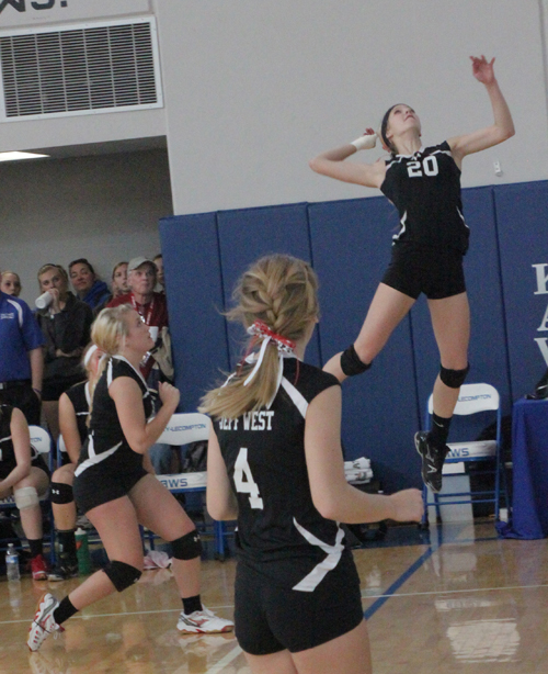 Bailey Harvey (#20) goes high to return the ball for the Jefferson West Lady Tigers in their volleyball match with the Bishop Ward Lady Cyclones in sub-state action at Perry Saturday. Photos by Ken Locke
