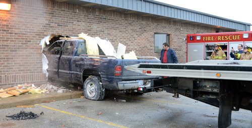The Dodge pickup is pulled from the clinic by a cable on Highway 4 Automotive's tow truck.