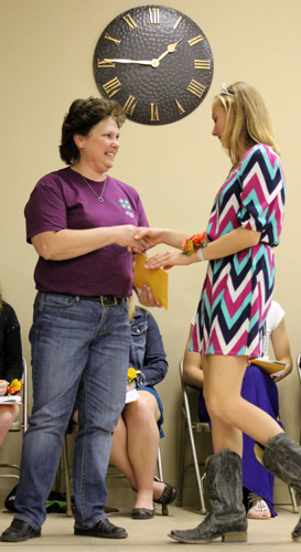 Photos by Bridget Weishaar Brenda Lloyd, left, is presented a 15-year leadership award by Annabelle Vaught for her help with the clothing and swine projects in the Prosperity 4-H Club. She is also a sponsor for the exchange trips. Other leaders recognized were Pat Winsor, 15 years, and Dan Courtney, 25 years. Annabelle is this year's 4-H princess.