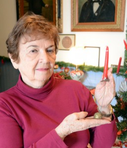 Elsie Middleton displays a candleholder once used to light a Christmas tree.