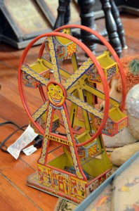 Members' antique toys are on display beneath one tree, including Paul Bahnmaier's childhood Ferris wheel.