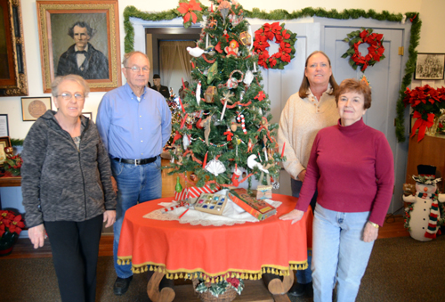 Lecompton Historical Society members who have turned the Territorial Capital Museum into a Christmas wonderland are, from left, Vicki Leochner, tour guide, Paul Bahnmaier, president, Deb Powell, board member, and Elsie Middleton, curator.