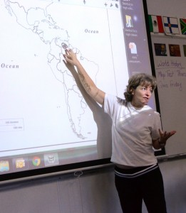 World history teacher Deb Spade calls on students to mark certain locations on their iPads during a geography lesson on the Western Hemisphere.