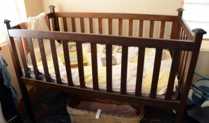 This baby bed was donated in 1995, but it was unknown where it came from. After taking a visit to the museum, Mildred Gilleece Olden was delighted to see the crib as she recognized it was one her uncle, Robert Nesbitt, had made for her in 1918.