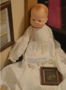 he doll pictured is wearing a baby dress that belonged to Alice Gardiner Sennrich. It was donated to the museum by her family in 1971. Betty Jane Wilson, society president, pointed out how good of condition the white dress with no yellowing was in.