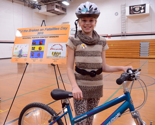 "Heather Kahler, Meriden, was awarded a bicycle and a helmet for her winning entry in the ""Put the Brakes on Fatalities"" poster contest sponsored by the Kansas Department of Transportation."