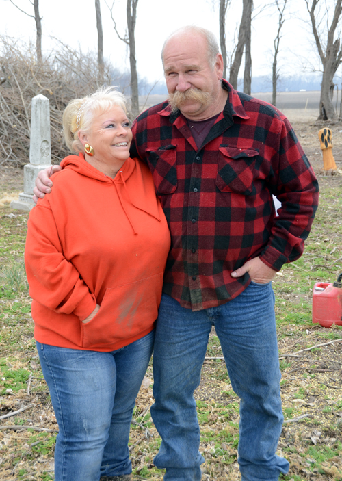 "Vicki and Pat Langton have spent the past 11 months restoring the Medina Cemetery. The chain saw carvers got married soon after graduating with the Perry-Lecompton class of 1977. ""She's the reason I took home ec,"" Pat said."