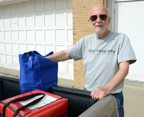 James Clulo leaves the township hall with hot meals for several clients in Valley Falls. He is one of the many volunteers who deliver Meals on Wheels.