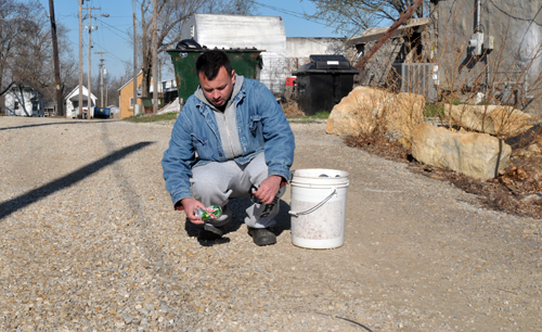 Tim Aydukovich is an avid aluminum can collector and at it daily about Oskaloosa. Photo by Rick Nichols.