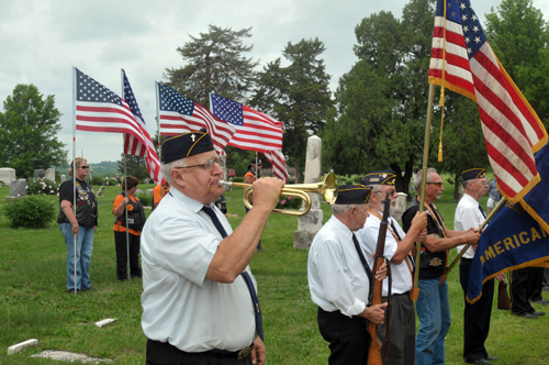 Bugler Francis Stockton plays taps to close ceremonies Memorial Day at Pleasant View Cemetery. Photo by Rick Nichols