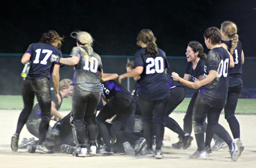 The Bulldogs celebrate after pitcher Shannon Green drives in the winning run. Photo by Bridget Weishaar