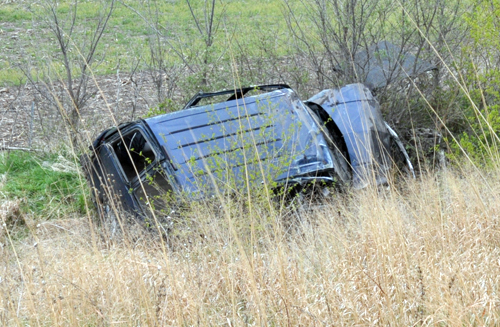 The 1999 Chevrolet Tahoe the suspect was driving came to rest at the bottom of the embankment along the south side of US-24.