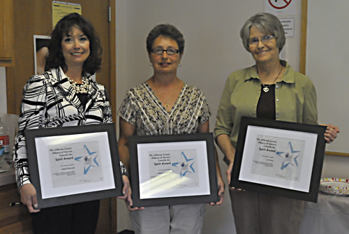 Heidi Pickerell, left, Pam King, center, and Jo Cross display the Spirit of Humanitarianism Awards they received last week from the Jefferson County Alliance of Service Councils Inc.
