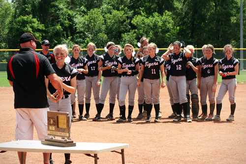 The Jefferson West girls' softball team line up for individual medals after winning third place in the 4A state tournament at Pratt Friday. Photo by Matt Hirsch